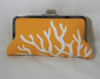 Golden yellow with white coral clutch with chevron lining.