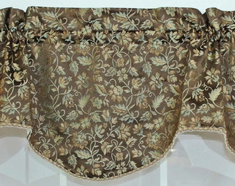 Floral shaped valance with trim in brown, spa blue , and rust.