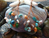 Earrings Washed up from the Ocean with Sea Glass, Mother of Pearl Beads, Wooden beads, and Glass Beads