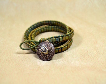 Triple Wrap Bracelet with Metalliic Green Miyuki Beads and Antique Copper Button on Distressed Green Leather Cord