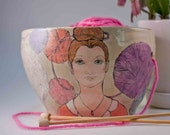 yarn bowl with images of a girl and balls of yarn all around her
