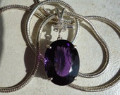 Oval Cut Amethyst Pendant with Triple Sapphire Accent