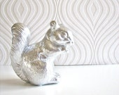Squire the Squirrel Statue in shiny silver