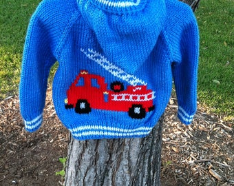 Hand knit child's hooded fire truck sweater