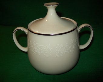 One (1), Noritake, Ivory China, Sugar Bowl with Lid, in the Lorelei Pattern.