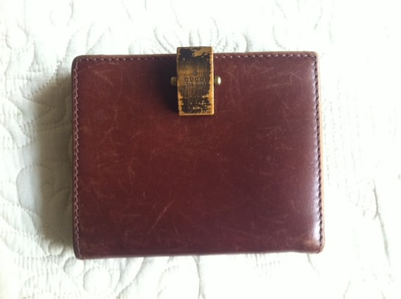 Vintage Gucci leather wallet in wine brown. Great vintage gift piece for Gucci lovers and collectors.