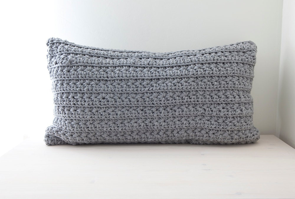 big grey crocheted pillow With big grey pillows