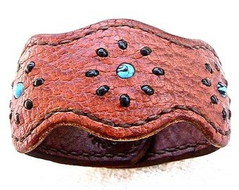 Lobed leather cuff / bracelet with turquoise and black glass bead inlay.