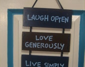 "Hanging Wooden Decor with Hand-painted Quote: ""Laugh Often, Love Generously, Live Simply"""