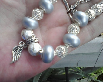Winged silk and silver Euro style bracelet