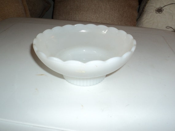 White scalloped, and footed ceramic bowl