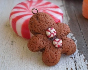 Wee little Gingerbread Man- polymer clay Christmas charm. peppermint candy buttons. winter pendant. Christmas ornament. Jettabugjewelry