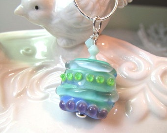 Necklace green blue purple glass lampwork bead, pale green crystals, square bead