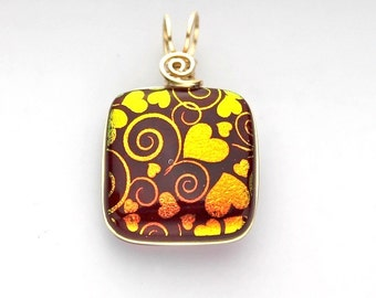 Wire Wrapped Red Dichroic Glass Pendant with Gold Hearts and Swirls