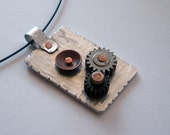 Mixed Metal Aluminum and Copper Pendant with Gear accent