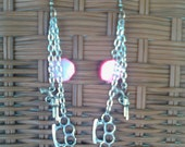 BRASS KNUCKLES & REVOLVER Earrings with a pink mop bead