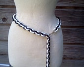 1970's Plastic Belt/Necklace. Alternating Black and White links with brass closure.
