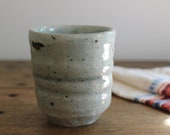 Coffee Cup. Stoneware with white slip and celadon glaze.