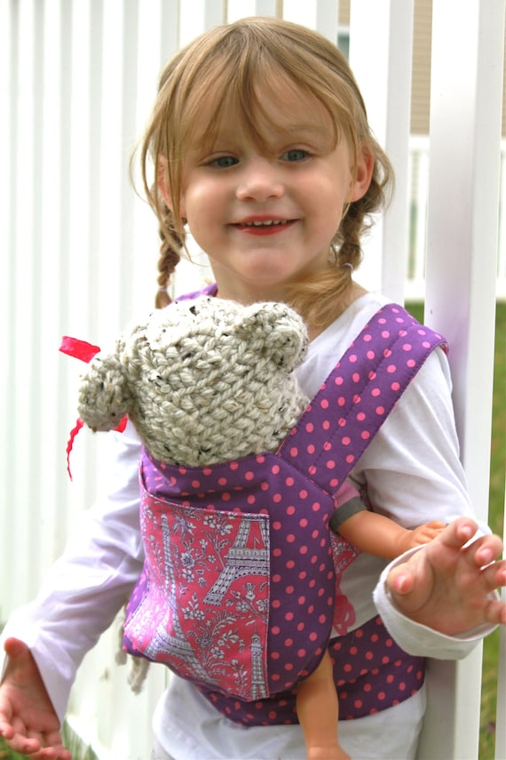 ... Little French Girls Baby Doll Carrier or Backpack in Purple and Pink: https://www.etsy.com/listing/157696417/ooh-la-lalittle-french-girls-baby-doll