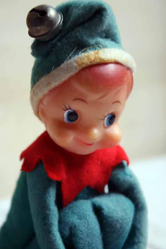 Vintage Christmas Elf Sits On A Shelf