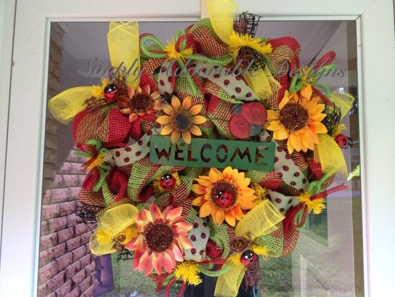 Bright and colorful summer wreath with ladybugs and sunflowers