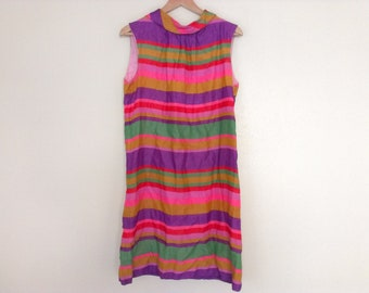 60s vintage medium ladies dress multi color, has tiny hole in front