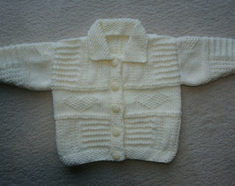 Hand knitted cream baby aran round neck cardigan with collar