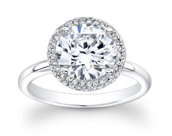 Ladies 14kt white gold diamond engagement ring with 2ct white sapphire center 0.30 ctw G-VS2 diamonds