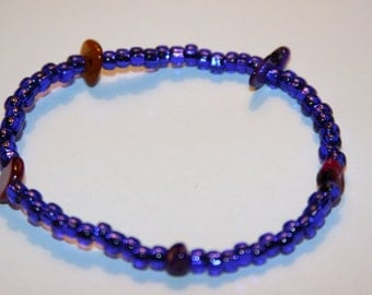 Stretchy purple and colorful bracelet.