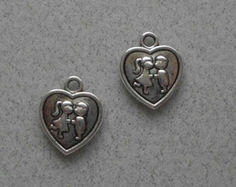 Silver Boy and Girl Kissing in a  Heart Charms