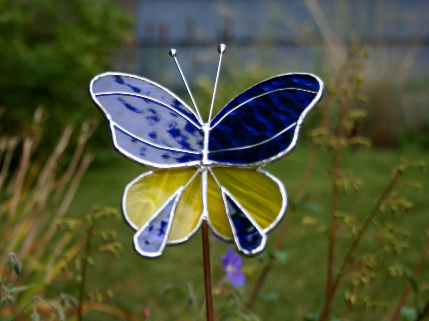 Stained glass butterfly garden ornament royal blue and yellow for Outdoor butterfly ornaments