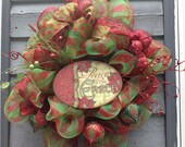 Christmas Wreath with Peace on Earth Sign