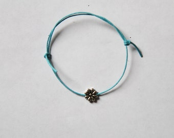 silver flower charm on waxed cotton cord adjustable friendship bracelet