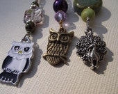Zipper pull with owls or peacock