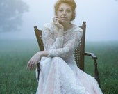 Vintage Blush and Lace Wedding Dress with Long Sleeves, Sweetheart Neckline, and a Small Train