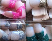 A set of 20 glitter tip nails including glue and file.
