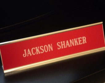 "Custom engraved 2"" x 8"" desk sign red/white letters - with silver aluminum holder"