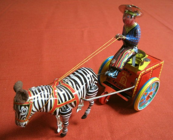 Tin Wind Up Collectible Mechanical Cart Riding Cowboy With Zebra