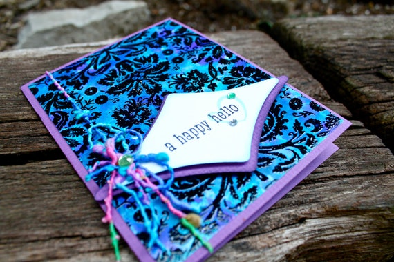 A happy hello card with purple and blue tones