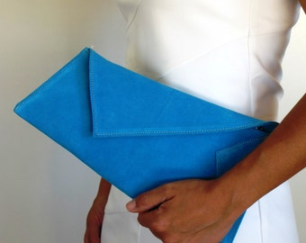 Leather geometric clutch medium size in many colors.