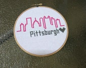 Modern Pittsburgh Skyline Cross Stitch in Pink and Gray