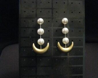 Sailor Moon earrings (anime version) or Luna human earrings