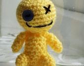 Baby voodoo-style monster (yellow).