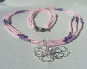 Pink Triple Strand with Wire Flower