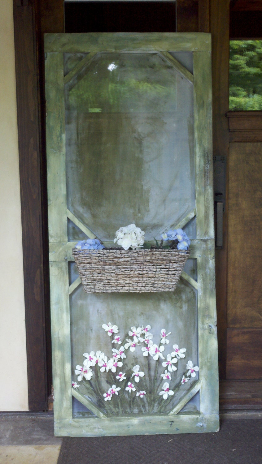 Old screen door decorative with a planter box on the front for Antique door decoration