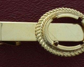 one 18x13 gold plated tie clip mounting