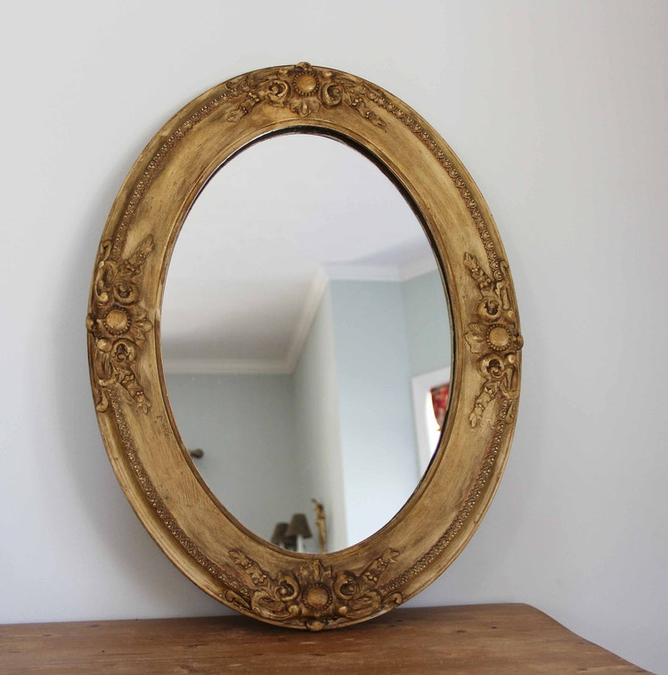 Antique oval wall mirror with carved wooden frame by ...