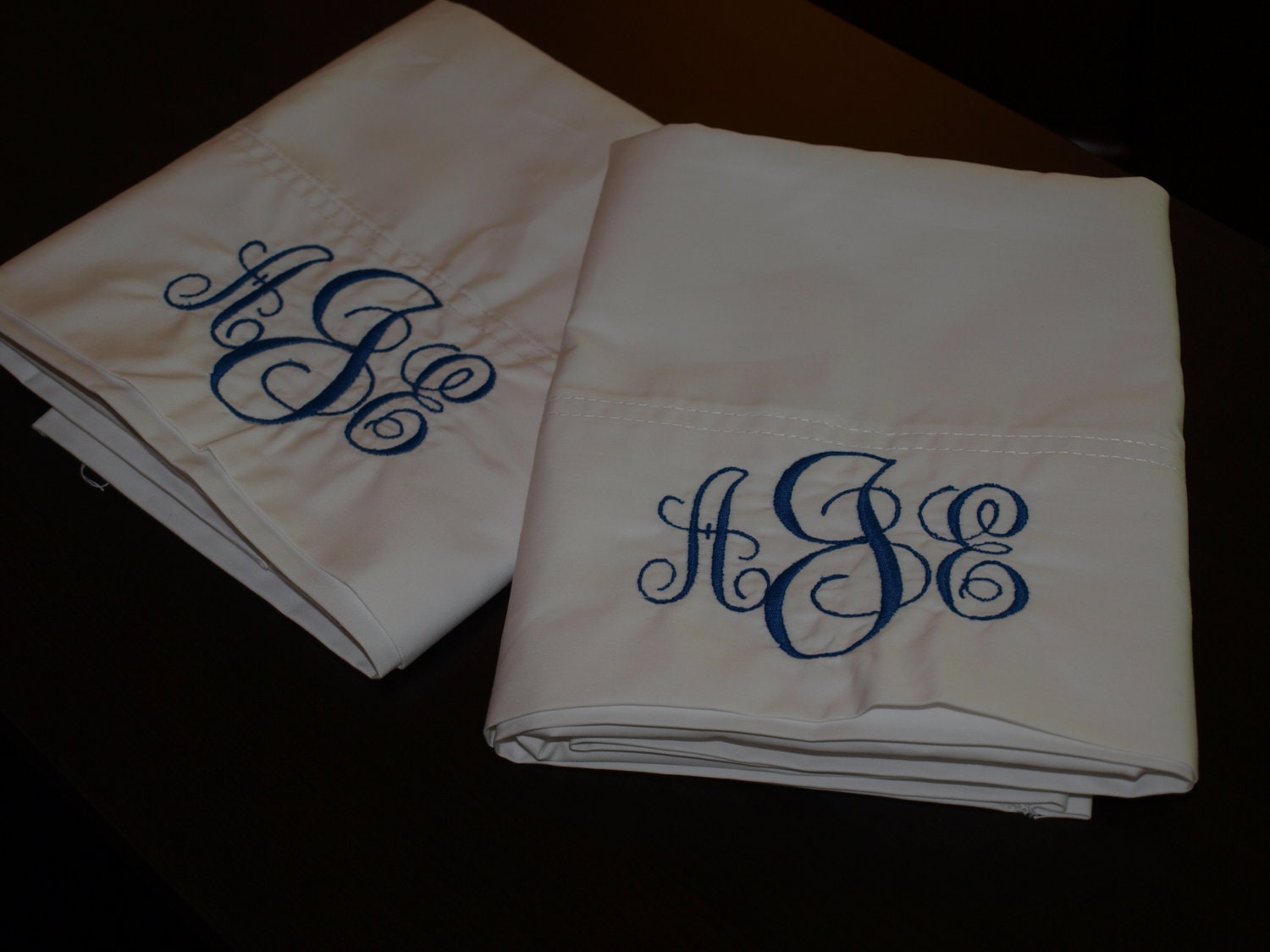 two custom monogrammed pillowcases by keepcalmandstitchon on etsy