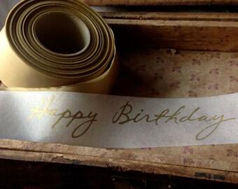happy birthday ribbon gold and ivory