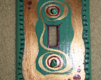 green paint and yarn switch plate cover
